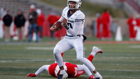 <p>               Utah State quarterback Jordan Love (10) runs for yardage after avoiding the tackle by New Mexico defensive lineman Joey Noble (98) during the second half of an NCAA college football game on Saturday, Nov. 30, 2019 in Albuquerque, N.M. (AP Photo/Andres Leighton)             </p>