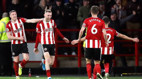 <p>               Sheffield United's Oliver McBurnie, second left, celebrates scoring his sides first goal of the game during the English Premier League soccer match between West Ham United and Sheffield United at Bramall Lane, Sheffield, England, Friday, Jan. 10, 2020. (Martin Rickett/PA via AP)             </p>