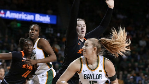<p>               Baylor forward Lauren Cox, right, drives on Oklahoma State center Kassidy De Lapp, left, in the second half of an NCAA college basketball game, Sunday, Jan. 12, 2020, in Waco, Texas. (Rod Aydelotte/Waco Tribune Herald via AP)             </p>