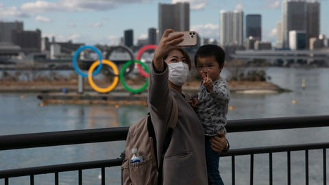 <p>               FILE - In this Wednesday, Jan. 29, 2020, file photo, a woman with a young boy takes a selfie with the Olympic rings, in Tokyo's Odaiba district. Tokyo Olympic organizers are trying to shoot down rumors that this summer's games might be cancelled or postponed because of the spread of a new virus. (AP Photo/Jae C. Hong, File)             </p>