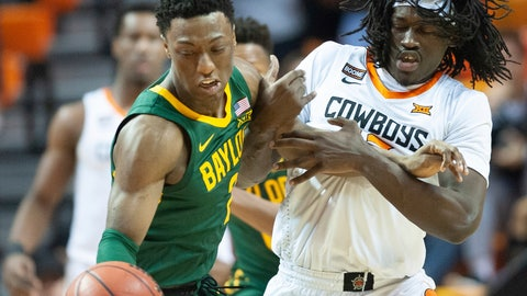 <p>               Oklahoma State guard Isaac Likekele, right, grabs the arm of Baylor guard Devonte Bandoo during the first half of an NCAA college basketball game in Stillwater, Okla., Saturday, Jan. 18, 2020. (AP Photo/Brody Schmidt)             </p>