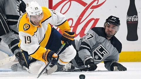 <p>               Nashville Predators center Calle Jarnkrok, left, passes the puck as he and Los Angeles Kings defenseman Alec Martinez fall to the ice during the second period of an NHL hockey game Saturday, Jan. 4, 2020, in Los Angeles. (AP Photo/Mark J. Terrill)             </p>