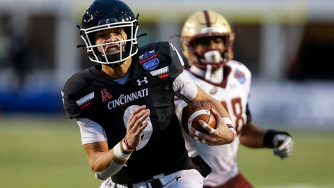 <p>               Cincinnati quarterback Desmond Ridder (9) carries the ball for a touchdown against Boston College during the first half of the Birmingham Bowl NCAA college football game Thursday, Jan. 2, 2020, in Birmingham, Ala. (AP Photo/Butch Dill)             </p>