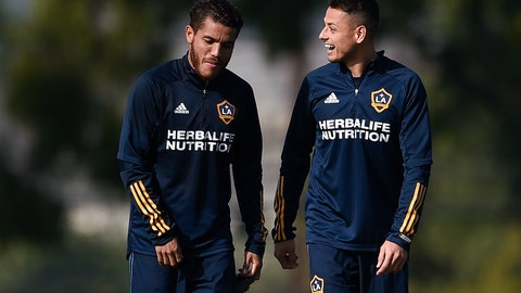 """<p>               Los Angeles Galaxy's Javier """"Chicharito"""" Hernández, right, speaks with Jonathan dos Santos during a practice in Carson, Calif., Thursday, Jan. 23, 2020. (AP Photo/Kelvin Kuo)             </p>"""