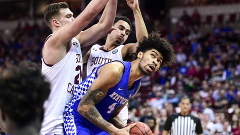 <p>               Kentucky forward Nick Richards (4) looks for a shot as South Carolina's Maik Kotsar, left, and Justin Minaya defend during the first half of an NCAA college basketball game Wednesday, Jan. 15, 2020, in Columbia, S.C. (AP Photo/Sean Rayford)             </p>