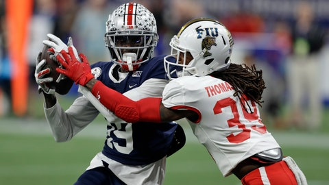 <p>               West wide receiver Binjimen Victor, of Ohio State, (19) pulls in a touchdown pass in front of East cornerback Stantley Thomas-Oliver III, of Florida International University, (39) during the second half of the East West Shrine football game Saturday, Jan. 18, 2020, in St. Petersburg, Fla. (AP Photo/Chris O'Meara)             </p>
