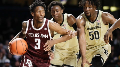 <p>               Texas A&M guard Quenton Jackson (3) drives against Vanderbilt defenders Saben Lee, center, and Ejike Obinna (50) in the first half of an NCAA college basketball game Saturday, Jan. 11, 2020, in Nashville, Tenn. (AP Photo/Mark Humphrey)             </p>