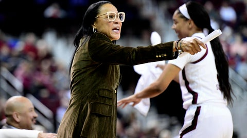 <p>               South Carolina coach Dawn Staley, left, communicates with players during the first half of an NCAA college basketball game against Arkansas, Thursday, Jan. 9, 2020, in Columbia, S.C. (AP Photo/Sean Rayford)             </p>