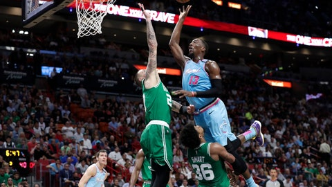 <p>               Miami Heat forward Bam Adebayo (13) goes to the basket as Boston Celtics center Daniel Theis (27) and guard Marcus Smart (36) defend during the first half of an NBA basketball game, Tuesday, Jan. 28, 2020, in Miami. Adebayo was called for an offensive foul on the play. (AP Photo/Lynne Sladky)             </p>