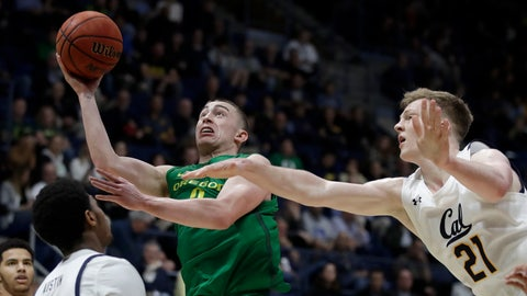 <p>               Oregon's Payton Pritchard, second from right, shoots past California's Lars Thiemann (21) in the second half of an NCAA college basketball game Thursday, Jan. 30, 2020, in Berkeley, Calif. (AP Photo/Ben Margot)             </p>