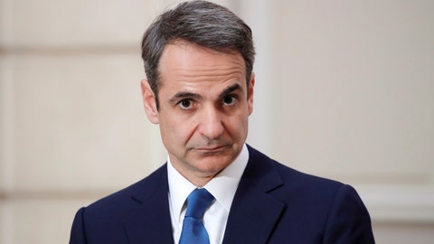 <p>               Greek Prime Minister Kyriakos Mitsotakis looks on during a joint press conference with French President Emmanuel Macron at the Elysee Palace in Paris, Wednesday Jan. 29, 2020. (Benoit Tessier/Pool via AP)             </p>
