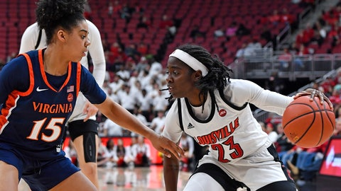 <p>               Louisville guard Jazmine Jones (23) looks to drive to the basket as she is defended by Virginia guard Kylie Kornegay-Lucas (15) during the second half of an NCAA college basketball game in Louisville, Ky., Thursday, Jan. 23, 2020. Louisville won 71-56. (AP Photo/Timothy D. Easley)             </p>