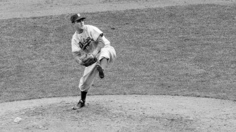 """<p>               FILE - In this October 1952 file photo, Brooklyn Dodgers' Carl Erskine pitches against the New York Yankees in Game 5 of the baseball World Series in New York. Up by 13 1/2 games in mid-August in 1951, Jackie Robinson and the Dodgers seemed destined. That was until rookie Willie Mays and the New York Giants came flying back, fueled by an incredible, late run in home games at the Polo Grounds, and forced a best-of-three playoff for the National League pennant. Erskine was warming up in the Brooklyn bullpen in Game 3 when Bobby Thomson connected for the famed """"Shot Heard 'Round the World,"""" a three-run homer in the bottom of the ninth off Ralph Branca that rallied the Giants to a 5-4 win. A half-century later, a giant secret was revealed: The Giants had rigged a spyglass-and-buzzer system in late July to steal catchers' signals and tip off their hitters. (AP Photo, File)             </p>"""