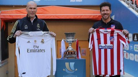 <p>               Atletico Madrid's head coach Diego Simone, right, stands with Real Madrid's head coach Zinedine Zidane during the trophy photo call at King Abdullah stadium, in Jiddah, Saudi Arabia, Saturday, Jan. 11, 2020, ahead of their Spanish Super Cup Final soccer match between Real Madrid and Atletico Madrid on Sunday. (AP Photo/Hassan Ammar)             </p>