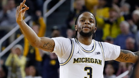 <p>               Michigan guard Zavier Simpson celebrates a 3-point basket against Purdue in the second overtime during an NCAA college basketball game in Ann Arbor, Mich., Thursday, Jan. 9, 2020. Michigan won 84-78. (AP Photo/Paul Sancya)             </p>