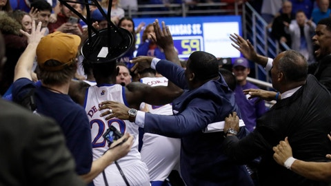 <p>               A fight between players spills into the crowd during the second half of an NCAA college basketball game between Kansas and Kansas State in Lawrence, Kan., Tuesday, Jan. 21, 2020. Kansas defeated Kansas State 81-59. (AP Photo/Orlin Wagner)             </p>