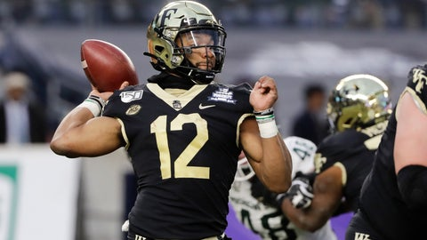 <p>               Wake Forest's Jamie Newman (12) throws a pass during the first half of the Pinstripe Bowl NCAA college football game against Michigan State, Friday, Dec. 27, 2019, in New York. (AP Photo/Frank Franklin II)             </p>