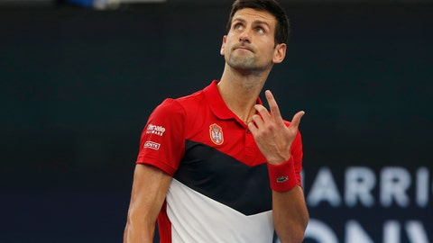 <p>               Novak Djokovic of Serbia reacts during their ATP Cup tennis match against Denis Shapovalov of Canada in Sydney, Friday, Jan. 10, 2020. (AP Photo/Steve Christo)             </p>