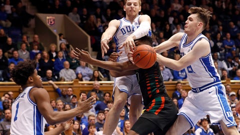 <p>               Miami forward Anthony Walker is blocked by Duke forward Jack White and forward Matthew Hurt (21) while center Vernon Carey Jr. (1) looks on during the first half of an NCAA college basketball game in Durham, N.C., Tuesday, Jan. 21, 2020. (AP Photo/Gerry Broome)             </p>