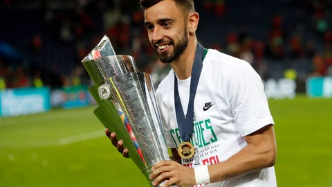<p>               FILE - In this June 9, 2019, file photo, Portugal's Bruno Fernandes poses with the trophy at the end of the UEFA Nations League final soccer match between Portugal and Netherlands at the Dragao stadium in Porto, Portugal.  According to news reports Wednesday, Jan. 29, 2020, Lisbon's Sporting CP midfielder Fernandes is expected to join Manchester United following months of negotiations between the two clubs. (AP Photo/Armando Franca, FILE)             </p>
