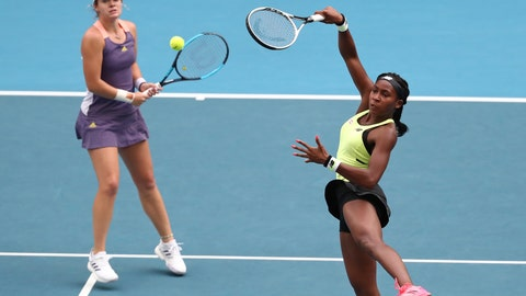 <p>               United States' Coco Gauff, right, and compatriot Caty McNally play in their third round doubles match against Japan's Shuko Aoyama and Ena Shibahara at the Australian Open tennis championship in Melbourne, Australia, Monday, Jan. 27, 2020. (AP Photo/Dita Alangkara)             </p>
