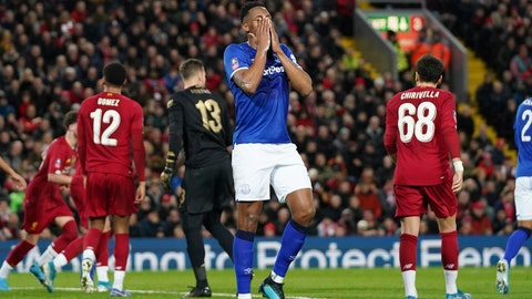 <p>               Everton's Cenk Tosun reacts after missing a scoring chance during the English FA Cup third round soccer match between Liverpool and Everton at Anfield stadium in Liverpool, England, Sunday, Jan. 5, 2020. (AP Photo/Jon Super)             </p>