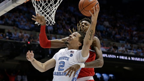 <p>               North Carolina guard Cole Anthony (2) drives to the basket while Ohio State forward Alonzo Gaffney defends during the first half of an NCAA college basketball game in Chapel Hill, N.C., Wednesday, Dec. 4, 2019. (AP Photo/Gerry Broome)             </p>