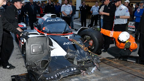 <p>               FILE - In this Thursday, Jan. 23, 2020, file photo, safety personnel unload the wreckage of the Acura Team Penske car driven by Ricky Taylor, not pictured, during qualifying for the Rolex 24 hour auto race at the Daytona International Speedway, in Daytona Beach Fla. The Penske crew had it repaired in time to get back on track and ready for the Saturday start of the endurance race. (AP Photo/Reinhold Matay)             </p>