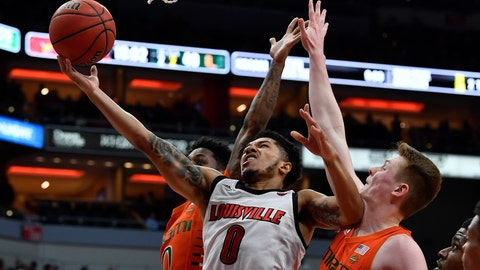 <p>               Louisville guard Lamarr Kimble (0) shoots between Miami guard Chris Lykes (0) and forward Sam Waardenburg (21) during the second half of an NCAA college basketball game in Louisville, Ky., Tuesday, Jan. 7, 2020. Louisville won 74-58. (AP Photo/Timothy D. Easley)             </p>