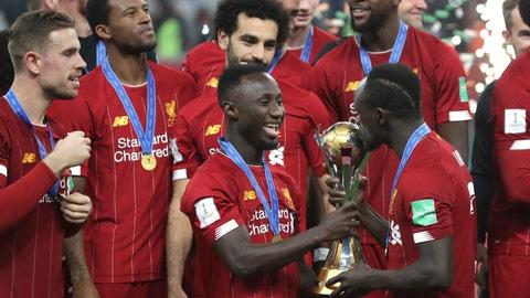 <p>               Liverpool's Sadio Mane kisses the trophy after winning the Club World Cup final soccer match between Liverpool and Flamengo at Khalifa International Stadium in Doha, Qatar, Saturday, Dec. 21, 2019. (AP Photo/Hassan Ammar)             </p>