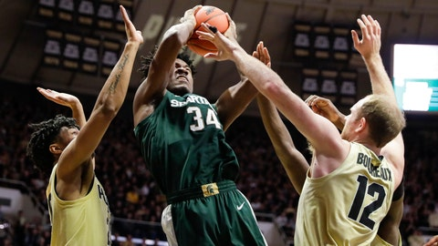 <p>               Michigan State forward Julius Marble (34) is defended by Purdue forward Evan Boudreaux (12) and Purdue guard Nojel Eastern (20) as he shoots during the first half of an NCAA college basketball game in West Lafayette, Ind., Sunday, Jan. 12, 2020. (AP Photo/Michael Conroy)             </p>