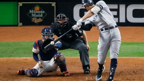 <p>               FILE - In this Oct. 13, 2019, file photo, New York Yankees' Aaron Judge hits a two-run home run against the Houston Astros during the fourth inning in Game 2 of baseball's American League Championship Series in Houston. Judge agreed to an $8.5 million, one-year contract Friday, Jan. 10, 2020, with the Yankees. (AP Photo/Sue Ogrocki, File)             </p>