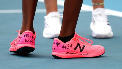 <p>               United States' Coco Gauff, front, and compatriot Caty McNally wear a tribute to Kobe Bryant on their shoes during their doubles match against Japan's Shuko Aoyama amd Ena Shibahara at the Australian Open tennis championship in Melbourne, Australia, Monday, Jan. 27, 2020. (AP Photo/Dita Alangkara)             </p>