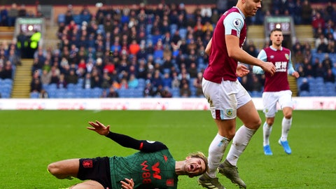 <p>               Burnley's James Tarkowski, right, collides with Aston Villa's Jack Grealish and receives a yellow card, during the English Premier League soccer match between Burnley and Aston Villa, at Turf Moor, Burnley, England, Wednesday Jan. 1, 2020. (Anthony Devlin/PA via AP)             </p>