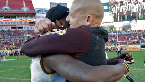 <p>               Minnesota head coach P.J. Fleck, right, hugs wide receiver Tyler Johnson after Minnesota defeated Auburn during the Outback Bowl NCAA college football game Wednesday, Jan. 1, 2020, in Tampa, Fla. (AP Photo/Chris O'Meara)             </p>