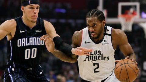 <p>               Los Angeles Clippers forward Kawhi Leonard, right, drives around Orlando Magic forward Aaron Gordon during the second half of an NBA basketball game in Los Angeles, Thursday, Jan. 16, 2020. The Clippers won 122-95. (AP Photo/Chris Carlson)             </p>
