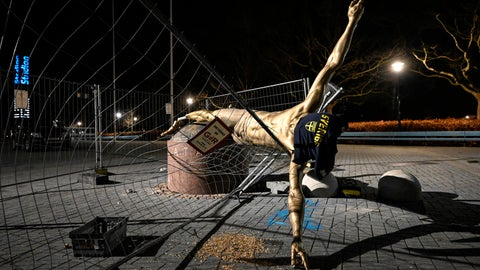 """<p>               The damaged statue of soccer player Zlatan Ibrahimovic next to Stadion football arena in Malmo, Sweden, Sunday Jan. 5, 2020. Ibrahimovic, who recently joined Italian side AC Milan, angered fans of his boyhood club, Malmo, in November when he bought a stake in one of Swedish title rivals, Hammarby, and outlined his desire to make the Stockholm-based team """"the best in Scandinavia"""". (Johan Nilsson/TT via AP)             </p>"""