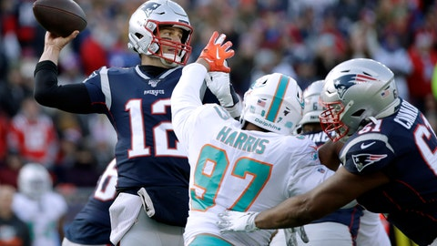<p>               New England Patriots quarterback Tom Brady, left, passes under pressure from Miami Dolphins defensive end Trent Harris in the first half of an NFL football game, Sunday, Dec. 29, 2019, in Foxborough, Mass. (AP Photo/Elise Amendola)             </p>