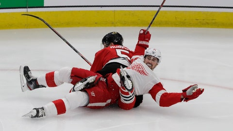<p>               Detroit Red Wings center Dylan Larkin (71) reacts after he was checking by Chicago Blackhawks defenseman Connor Murphy (5) during the first period of an NHL hockey game in Chicago, Sunday, Jan. 5, 2020. (AP Photo/Nam Y. Huh)             </p>