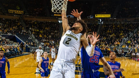<p>               Michigan forward Isaiah Livers (2) attempts a dunk ahead of Presbyterian guard JC Younger (25) in the first half of an NCAA college basketball game at Crisler Center in Ann Arbor, Mich., Saturday, Dec. 21, 2019. (AP Photo/Tony Ding)             </p>