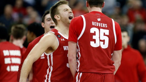 <p>               Wisconsin guard Brad Davison, left, celebrates with teammate forward Nate Reuvers during the final seconds of the second half of an NCAA college basketball game against Ohio State in Columbus, Ohio, Friday, Jan. 3, 2020. (AP Photo/Paul Vernon)             </p>