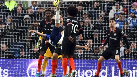 <p>               Brighton's Alireza Jahanbakhsh, centre, scores his side's first goal of the game, during the English Premier League soccer match between Brighton and Chelsea at the AMEX Stadium, Brighton, England, Wednesday Jan. 1, 2020. (Gareth Fuller/PA via AP)             </p>