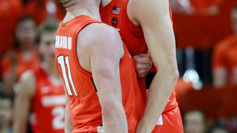 <p>               Syracuse guard Buddy Boeheim (35) celebrates a there point play with teammate Syracuse guard Joseph Girard III (11) during the second half of an NCAA college basketball game in Charlottesville, Va., Saturday, Jan. 11, 2020. Syracuse defeated Virginia 63-55 in overtime. (AP Photo/Steve Helber)             </p>