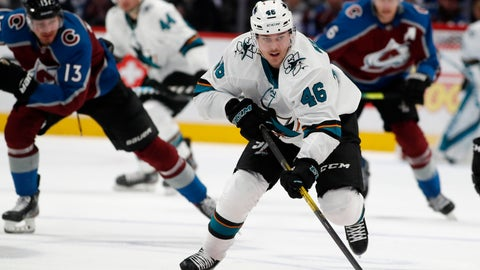 <p>               San Jose Sharks center Joel Kellman, front, drives down the ice with the puck with Colorado Avalanche right wing Valeri Nichushkin, back left, and defenseman Erik Johnson in pursuit during the second period of an NHL hockey game Thursday, Jan. 16, 2020, in Denver. (AP Photo/David Zalubowski)             </p>