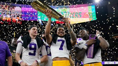 <p>               LSU safety Grant Delpit holds the trophy as quarterback Joe Burrow, left, and linebacker Patrick Queen look on after a NCAA College Football Playoff national championship game against Clemson, Monday, Jan. 13, 2020, in New Orleans. LSU won 42-25. (AP Photo/David J. Phillip)             </p>