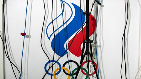 <p>               Wires go to microphones above a logo of the Russian Olympic Committee during President of the Russian Olympic Committee Stanislav Pozdnyakov's news conference in Moscow, Russia, Monday, Dec. 9, 2019. The World Anti-Doping Agency has banned Russia from the Olympics and other major sporting events for four years, though many athletes will likely be allowed to compete as neutral athletes. (AP Photo/Pavel Golovkin)             </p>