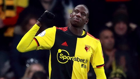 <p>               Watford's Abdoulaye Doucoure celebrates scoring his side's second goal of the game, during the English Premier League soccer match between Watford and Wolverhampton Wanderers at Vicarage Road, in Watford, England, Wednesday, Jan. 1, 2020. (Adam Davy/PA via AP)             </p>