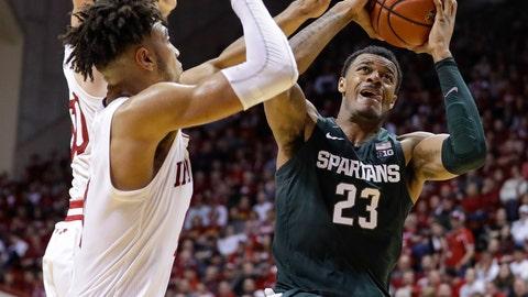 <p>               Michigan State forward Xavier Tillman (23) shoots over Indiana forward Trayce Jackson-Davis (4) in the second half of an NCAA college basketball game in Bloomington, Ind., Thursday, Jan. 23, 2020. (AP Photo/Darron Cummings)             </p>