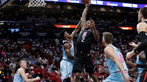 <p>               Los Angeles Clippers forward Kawhi Leonard (2) drives to the basket as Miami Heat forward Jimmy Butler defends during the first half of an NBA basketball game, Friday, Jan. 24, 2020, in Miami. (AP Photo/Lynne Sladky)             </p>