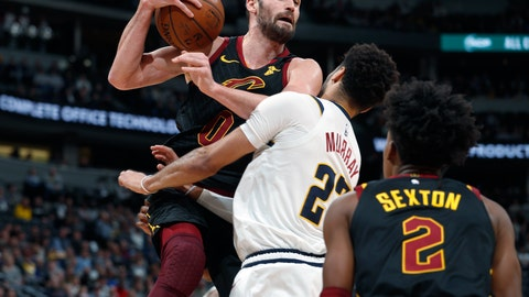 <p>               Cleveland Cavaliers forward Kevin Love, left, pulls in a rebound as Denver Nuggets guard Jamal Murray, center, defends while Cleveland guard Collin Sexton watches during the first half of an NBA basketball game Saturday, Jan. 11, 2020, in Denver. (AP Photo/David Zalubowski)             </p>